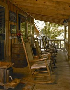 """""""The porch is ideal for sitting and drinking sweet tea."""" The Baker residence, built with salvaged materials. Photo by Michael Shopenn. Massage Place, Face Massage, Massage Chair, Outdoor Spaces, Outdoor Living, Home Goods Decor, Home Decor, Cabins In The Woods, Back To Nature"""