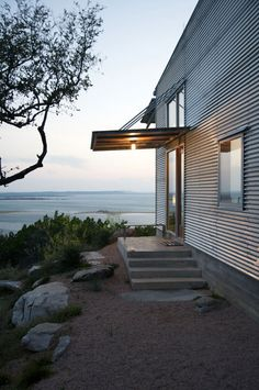 Facade Fix: 9 Ways to Add Curb Appeal with Corrugated Metal Siding (Gardenista: Sourcebook for Outdoor Living) Steel Framing, Metal Siding, Modern Cottage, Corrugated Metal, Galvanized Metal, Marquise, Metal Homes, Simple House, Curb Appeal