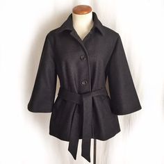 """Gap Belted Swing Coat✨Host Pick✨ Classic retro-inspired Gap wool blend swing coat in a charcoal gray neutral. The three quarter sleeves have a bell shape. Four button closure with a belt and two side slant pockets. There is a subtle herringbone type pattern. Bell shape. Fully lined. 70% wool; 17% nylon; 13% polyester. Dry clean only. Size Medium. Bust: 20"""" flat across. Waist: 21"""" flat across, unbelted. Length: 26"""". Shoulder width: 16"""". New condition. Thanks for looking! GAP Jackets & Coats"""