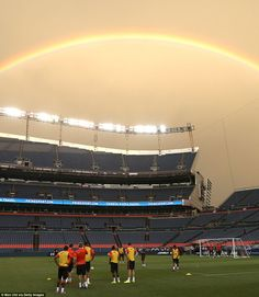 Somewhere over the rainbow: Manchester United players train at the Sports Authority Field ...