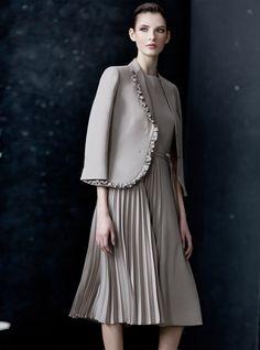 Superfine wool ruffle border jacket and fluid side pleated hemline dress.
