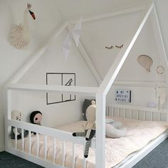 In love with this house bed and those long-lashed eyes on the wall...#estella #kids #decor