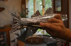 With skill, patience; Tuck & Holand Metal Sculptors; weathervane detail; Vineyard Haven, Massachusetts, USA.  July 2012.