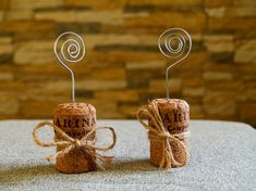 Easy DIY! Champagne Cork Place Card Holder - stick a wire on top, loop it and call it a day!