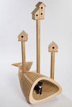"""HKS's """"CAnT WE ALL GET ALONG,"""" A Humorous Composition Of A Fish-Shaped Shelter With Birdhouses Above"""
