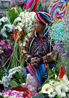 Holy Week Flower Market at Chichicastenago, Guatemala ~ photo by Stacey J. Meanwel/SHE blends in so well w/ the flowers,what a beauty! We Are The World, People Around The World, Wonders Of The World, Around The Worlds, Holy Week, Flower Market, Honduras, World Cultures, Belize
