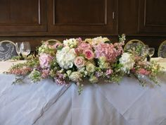 """Top Table Ignoring colour choice-something quite traditional but still """"soft"""" for the top table arrangment"""
