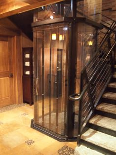 Custom home elevator in a beautiful rustic home.