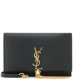 """Crafted in Italy from smooth """"Algae"""" green calf leather, Saint Laurent's Kate Tassel crossbody bag features a wallet-style interior with card slots for organization. The piece is decorated with the label's iconic YSL . Leather Ankle Boots, Calf Leather, Sac Yves Saint Laurent, Ysl Bag, Gucci, Small Shoulder Bag, Shoulder Strap, Online Bags, Green Leather"""