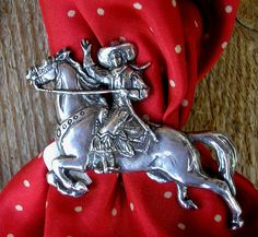 The early 20th century cowgirl as a scarf slide.  All sterling.  Also available in gold - call for a price quote.  Please Note: Item may n...