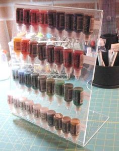 Description: Used 11x14 free standing acrylic frame, strips of velcro, and velcro dots on bottles. Will hold 44 bottles of Stickles. (Thanks to Annjill for putting the idea in my head!) P.S. - PLEASE FEEL FREE TO COPY, I just did!