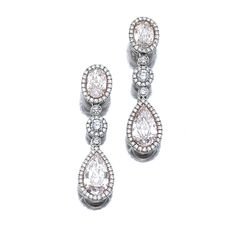 Pair of fancy coloured diamond pendent earrings | lot | Sotheby's