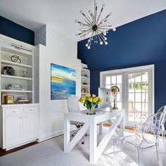 Wall color is Benjamin Moore Van Deusen Blue. One of the best transitional dark blues because of the balanced mix of warm and cool tones.  Clean Design Partners