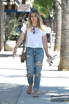 Pretty: Hilary Duff looked cute and casual as she stepped out for lunch with her family on Wednesday