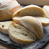 Mix it once (no kneading needed!) and have rustic, European-style bread ready to bake all week long! This deliciously simple recipes takes just a matter of minutes to make, and can be turned into several loaves of bread, or fresh hot homemade dinner rolls anytime you desire, because it can be stored in the fridge for up to 14-days! Simply make one batch, then bake the dough into fresh loaves whenever you're ready! Fresh bread all week long!