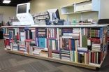 Circulation desk made out of books at our library