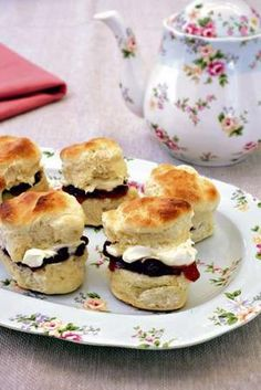 Scones with jam and clotted cream    1 tbsp icing sugar  310g (2 1/2 cups) plain flour  1 1/2 tbsp baking powder  A pinch of salt  250ml (1 cup) milk  30g butter, melted  Jam  Clotted cream