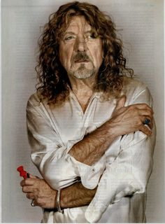 Robert Plant - I don't know what happned to this guy, but his band mates don't look nearly this beat up.