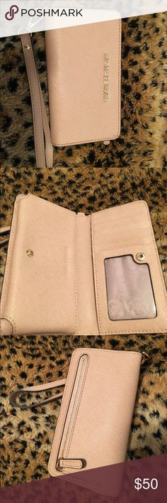 Michael Kors Tech Wristlet Blush pink color; only used twice. Holds iPhone 6, and other phones of that size. Wristlet piece can be removed to use it as a wallet. Michael Kors Bags Clutches & Wristlets
