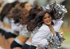 Raiders cheerleader sues, says pay is less than $5 an hour