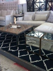 Distressed wood and metal coffee table ($495) with gorgeous mirrored cubes ($372).