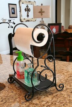 This is so cute if you put windex/ any cleaning product in a fancy bottle and put it on the stand w the paper towels!