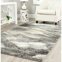 Create a focal point in any room with this unusual ivory rug. The Deco-inspired rug is crafted from polypropylene on a durable canvas backing and features a modern print in muted colors that complement a variety of home décor styles.