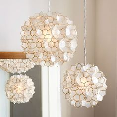 Capiz Flower Pendant | West Elm. Foyer or in master bedroom seating area. Comes in 3 sizes.