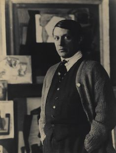 A Young Pablo Picasso in His Studio in Front of Paintings, 1921/1930s - Man Ray