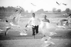 Buffalo NY Photography | www.knightstudio.com | Bride & Groom running on the beach