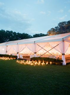 Candle hurricanes at tent entrance to wedding tent in Charleston, SC by Tara Guerard; photo by Corbin Gurkin