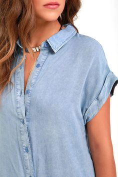 You'll be cool as a cucumber and cute as can be once you slip into the Keeping Cool Washed Blue Shirt Dress! Lightweight woven rayon in a washed blue hue is soft to the touch and has an easy-going look perfect for wearing on its own, with leggings or your favorite cardigan! A classic button-down collar tops this shirt dress style with a relaxed fit bodice, cuffed short sleeves, and a slight high-low hem. As Seen On Cara of A Fashion Love Affair blog!