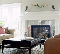 Mirrored fireplace surround.