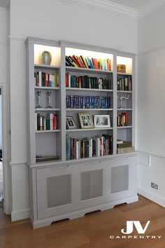 This peice of fitted furniture is a bookcase and radiator cover in one, made with LED light on the top