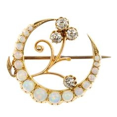 A Victorian opal and diamond crescent brooch