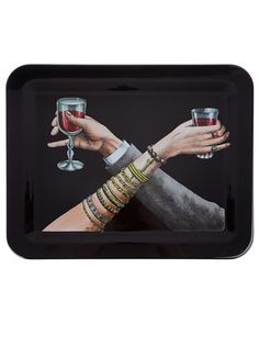 Black lacquered wood tray from Fornasetti featuring a coloured print of a man and woman crossing arms while holding glasses of wine.