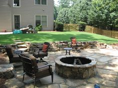 Tennessee Stack Fieldstone Retaining Wall and Flagstone Patio with Fire Pit by Edge Landscapes.