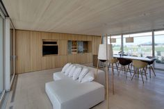 Sustainable Small House with Great Design: Lovely Living Room Of Sustainable Solar Home From Team Austria With White Sofa And White Cushions. White Cushions, White Sofas, Austria, Diy Floor Lamp, Innovation, Solar House, Decathlon, Beautiful Space, House In The Woods