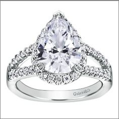 Gabriel & Co  This lovely pear-shaped diamond is set in a split shank white gold band.