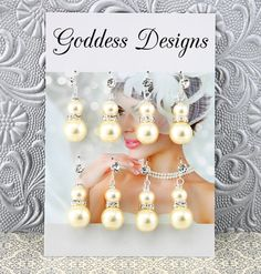"""Bridesmaid Earrings """"Set of Four"""" Wedding Earrings by goddessdesignsgems, $75.00 *This listing is for a """"Set of Four"""" pairs of earrings* These """"Fabulous"""" earrings feature a beautiful design with dazzling rhinestone crystal spacer(s) layered with two lustrous ivory pearls. Earrings are sparkly and beautiful with a very elegant look!"""