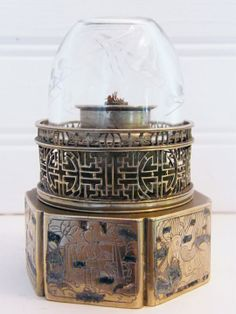 A paktung and niello opium lamp with longevity and domestic scenes from Fusian region circa 1880