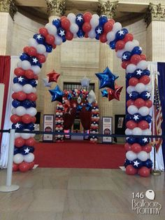 Red White and Blue Veterans' Day balloon arches at Union Station in Chicago!  The arches and stars helped break up the large space for the event! | Balloons by Tommy | #balloonsbytommy