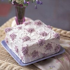 Create a beautiful Violet Cascade Cake by making drop flowers with Tip 129 and Tip 24 -- Perfect for all celebrations!