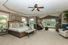 Transitional Master Bedroom with High ceiling, Rattan Drum Stool Brown, Carpet, Shaw Carpet - Beige, flush light, Ceiling fan