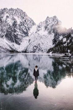Frozen Lake and Mountain | The reflection makes it look like the girl is almost on the top of the mountain!