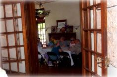 Anniversary party in the Elliott House - looking through dining room french doors into the sunken living room.
