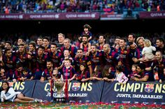 Players of FC Barcelona pose with the La Liga trophy after the La Liga match between FC Barcelona and RC Deportivo La Coruna at Camp Nou on May 23, 2015 in Barcelona, Catalonia.