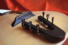 Brilliant Idea to use standard guitar machine heads on a headless guitar.  Sankey Guitars Tortoise headless acoustic tuner-tailpiece
