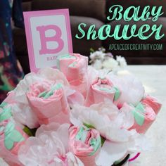 Baby shower planning? Try this spin on the traditional diaper cake and make diaper roses instead. Simply roll the diaper around a stick and secure with a clear elastic band. Mix with artificial flowers and stick into a foam base. Honest Co. diapers have the cutest prints and patterns. apeaceofcreativity.com
