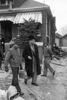 Malcolm X at his house, after two fire bombs sparked a flash fire, on the night before, almost certainly by the members of the Nation of Islam. In a week's time, Malcolm X would be assassinated. Native American Images, African American History, Native American Indians, African Tribes, African Men, African Attire, African Style, African Dress, Malcolm X